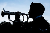 An Airmen from the 820th Base Defense Group plays a bugle during a Safeside reunion memorial, Nov.8, 2017, at Moody Air Force Base, Ga.  Biennially, the Safeside Association holds a reunion to interact with and honor their past and present comrades from the 820th Base Defense Group. (U.S. Air Force photo by Airman Eugene Oliver)