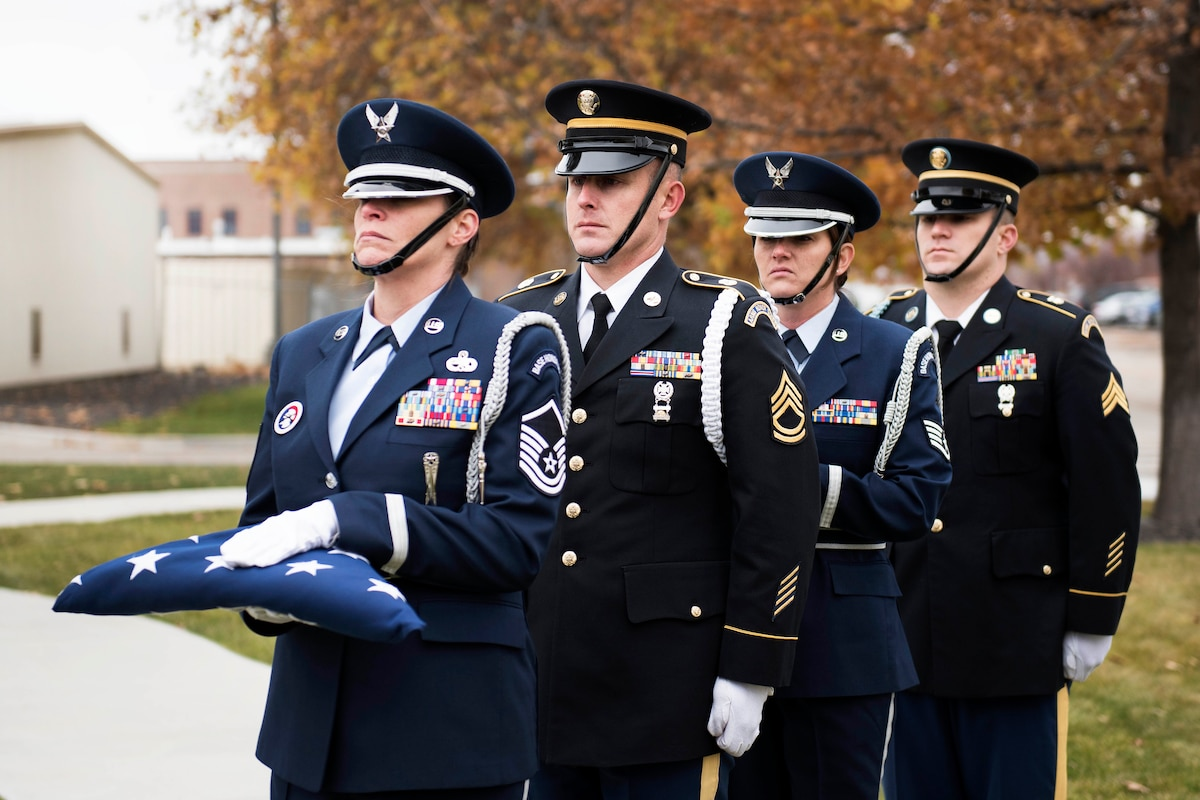 Idaho National Guardsmen carry and prepare to present the colors during a Veterans Day ceremony.