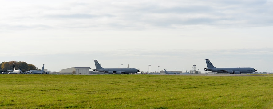 "Four KC-135 Stratotankers perform an ""elephant walk"" as they take off together Nov. 9, 2017, from RAF Mildenhall, England. The aircraft were participating in off-station training to practice four-ship formation procedures. Continual training is vital for our aircrew in ensuring the KC-135s are prepared to support U.S., NATO and partner aircraft in extending global reach. (U.S. Air Force photo by Karen Abeyasekere)"