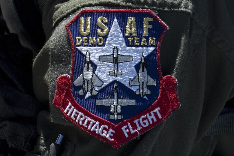 The United States Air Force Heritage Flight patch rests on the shoulder of Maj. Joseph Morrin, A-10 Heritage Flight Team pilot, during the Naval Air Station Jacksonville Air Show, Nov. 2, 2017, at NAS Jacksonville, Fla. The U.S. Air Force Heritage Flight program showcases past, present and future aircraft to spectators at air shows around the world. (U.S. Air Force photo by Staff Sgt. Eric Summers Jr.)