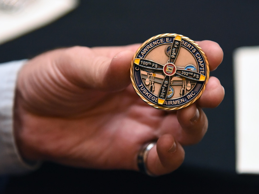 Lt. Col. Michael Manning, 81st Training Group deputy commander, displays a coin during the Tuskegee Airmen Inc. 8th Annual Benefit Gala at the Slavonian Lodge Nov. 4, 2017, in Biloxi, Mississippi. The event, which was held to raise funds for the Col. Lawrence E. Roberts Scholarships Fund, also included a silent auction and dinner. (U.S. Air Force photo by Kemberly Groue)