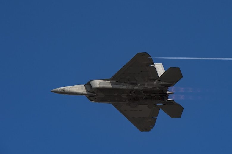 An F-22 Raptor performs a speed pass demonstrating a fraction of its top speed Nov. 5, 2017, at Naval Air Station Jacksonville, Fla. Maj. Daniel Dickinson, F-22 Raptor Demo Team pilot, performed display of capabilities before joining the Heritage Flight Formation. (U.S. Air Force photo by Staff Sgt. Eric Summers Jr.)