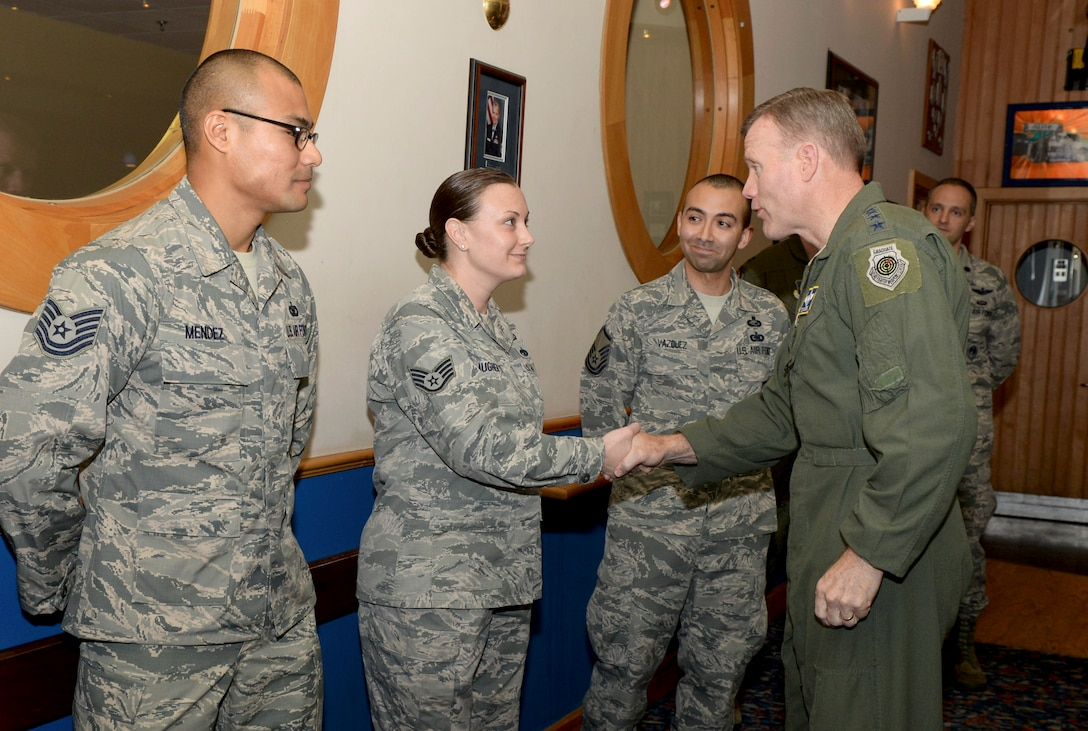 U.S. Air Force Gen. Tod D. Wolters, U.S. Air Forces in Europe and Air Forces Africa commander, coins U.S. Air Force Staff Sgt. Amy Daugherty, 100th Maintenance Group, at RAF Mildenhall, England, Nov. 9, 2017. During his visit, Wolters recognized outstanding Airmen from the 100th Air Refueling Wing and expressed his appreciation for their hard work. (U.S. Air Force photo by Senior Airman Tenley Long)