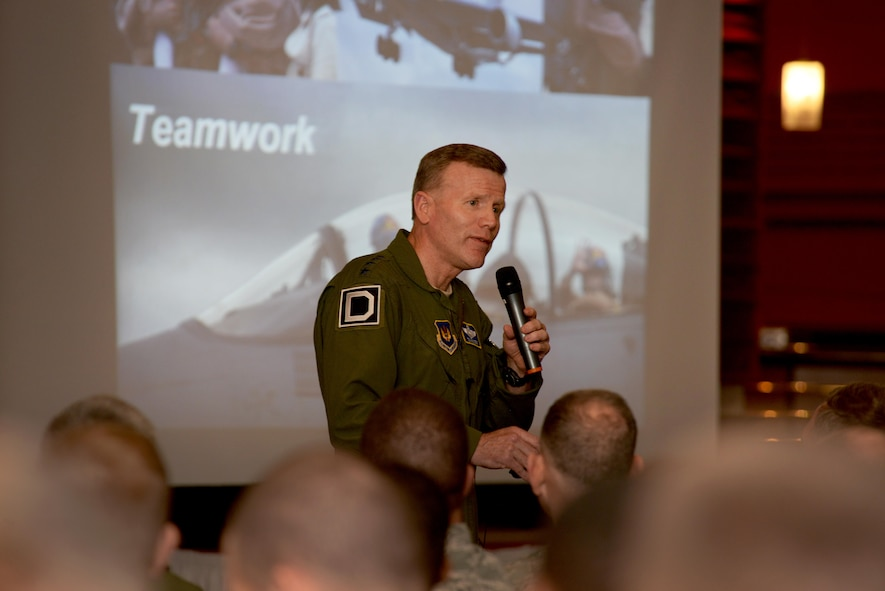 U.S. Air Force Gen. Tod D. Wolters, U.S. Air Forces in Europe and Air Forces Africa commander, speaks to Airmen of the 'Bloody Hundredth' during an all call at RAF Mildenhall, England, Nov. 9, 2017. During the all call, Wolters stressed the significance of the 100th Air Refueling Wing's role in the Air Force's mission in Europe and Africa. (U.S. Air Force photo by Senior Airman Tenley Long)