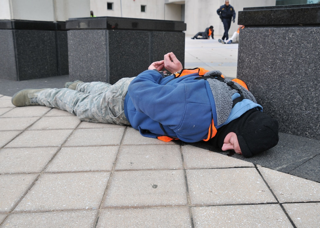 'Victim' played by employee lies prone as part of exercise.
