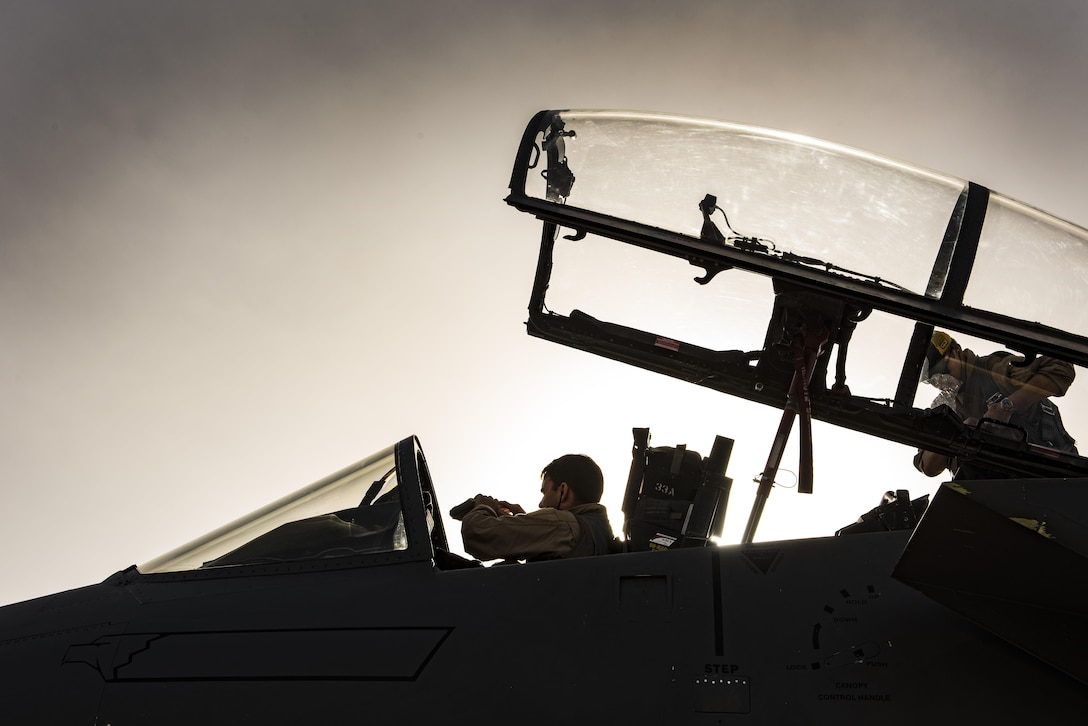 Aircrew members assigned to the 336th Expeditionary Fighter Squadron perform pre-flight checks prior to flying a sortie in support of Operation Inherent Resolve Nov. 3, 2017, in Southwest Asia. The squadron's primary objective is the protection and support of coalition forces on the ground via precision strikes and defensive counter-air operations. (U.S. Air Force photo by Senior Airman Joshua Kleinholz)