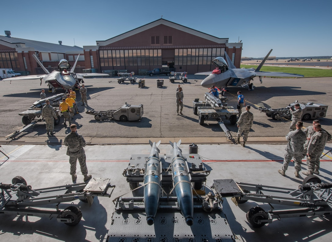 U.S. Air Force weapons load crew Airmen from the 94th and 27th Aircraft Maintenance Units compete in the 3rd Quarter Weapons Load Competition at Joint Base Langley-Eustis, Va., Nov. 3, 2017. Load crews supporting the 94th and 27th Fighter Squadrons competed to be the best for the 3rd quarter. (U.S. Air Force photo by Staff Sgt. Carlin Leslie)