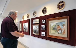 George Wunderlich, U.S. Army Medical Department Museum director, looks at a frame of a historical print in the museum's revamped AMEDD Regimental Room, which is used for various activities from change of command and retirement ceremonies to receptions to training demonstrations. The renovations to the room are part of several improvements being made at the museum to enhance the visitor experience.