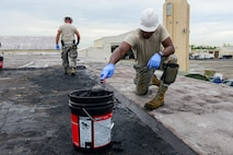 Tech. Sgt. Alfredo Diaz, 156th Civil Engineer Squadron structural team lead specialist, applies liquid asphalt coating to a damaged area Nov. 7, 2017, on Muñiz Air National Guard Base, Puerto Rico. The base requires significant repairs as the island continues to recover from Hurricane Maria. (U.S. Air National Guard photo by Staff Sgt. Daniel J. Martinez)