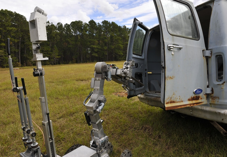 """A REMOTEC Andros F6A robot opens the doors of a """"suspicious"""" van during a routine training exercise at the Joint Base Charleston Naval Weapons Station Explosive Ordnance Disposal range, S.C., Nov. 2, 2017."""