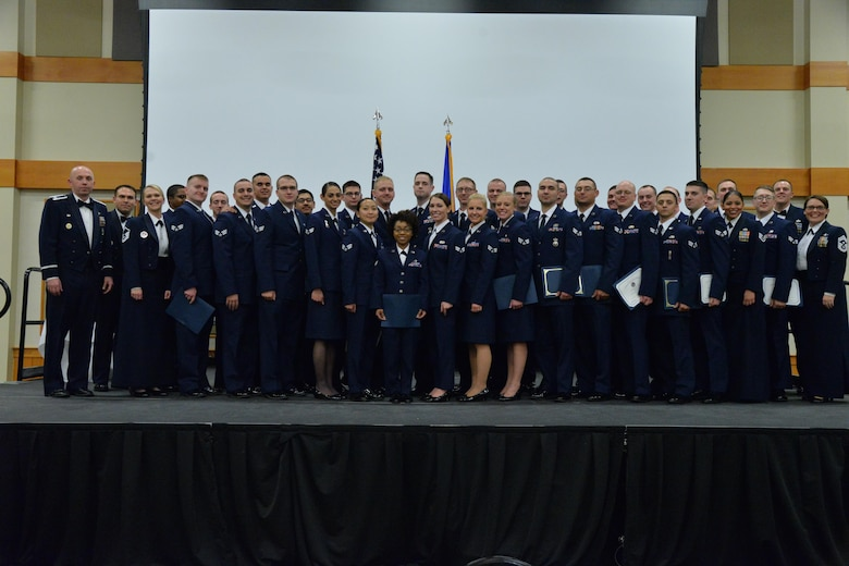 Graduates of Airman Leadership School Class 18-A pose for a photo after the graduation ceremony Nov. 9, 2017, at the Grizzly Bend at Malmstrom Air Force Base, Mont. (U.S. Air Force photo by Airman 1st Class Daniel Brosam)