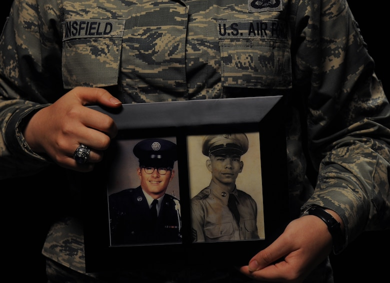 Senior Airman Holly Mansfield, 81st Training Wing Public Affairs photojournalist, holds a photo of her father, James Cook Jr., and grandfather, U.S. Army Master Sgt. retired James Cook Sr., Nov. 9, 2017, on Keesler Air Force Base, Mississippi. As a third generation military member, Mansfield carries on the legacy of service started by her grandfather who joined the Army in 1956 and her father who served in the Air Force during the Vietnam War. (U.S. Air Force photo by Senior Airman Holly Mansfield)