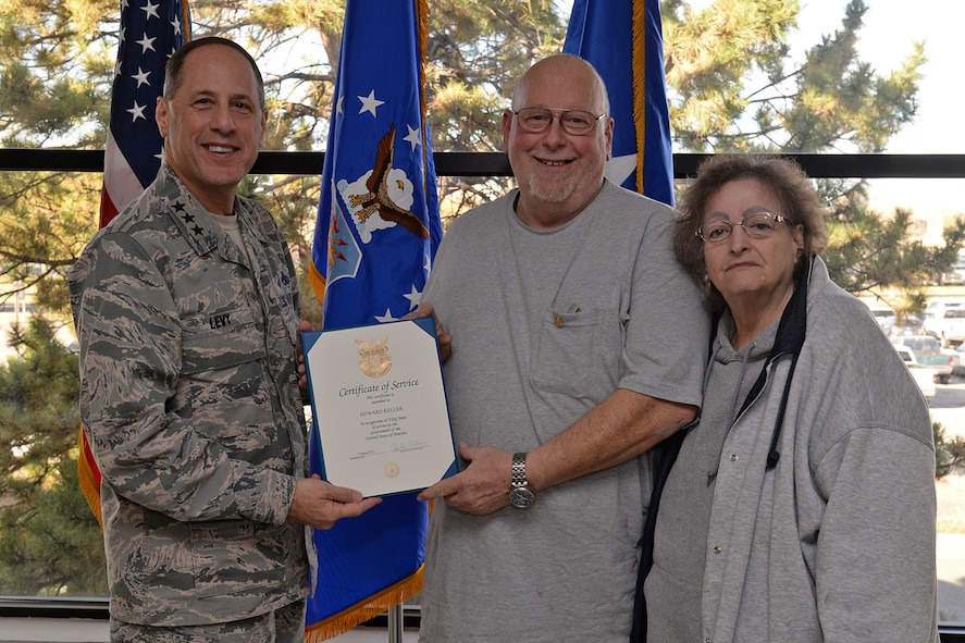 With his wife Virginia by his side, Edward Keller is presented his 50-year service certificate by Lt. Gen. Lee K Levy II, Air Force Sustainment Center commander, on Nov. 2, 2017 at Hill Air Force Base, Utah. (U.S. Air Force Photo by Alex R. Lloyd)