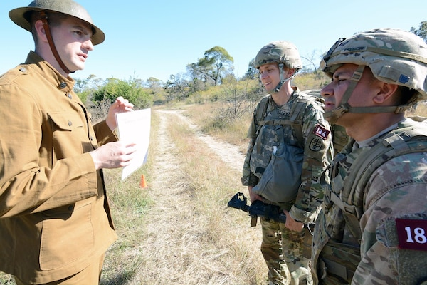 Dressed in WWI period uniform, Staff Sgt.Clint McKinley, AMEDDC&S, dressed in WWI period uniform, briefs Capt.Stona Jackson, 1LT Marco Presichi, Regional Health Command – Europe, on the DNBI / Orienteering lane.