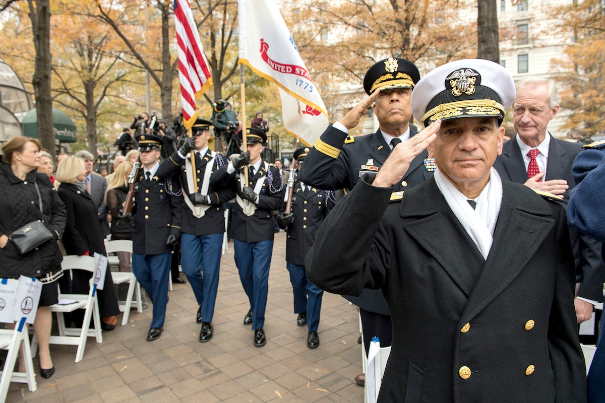 Service members render honors to the American flag.