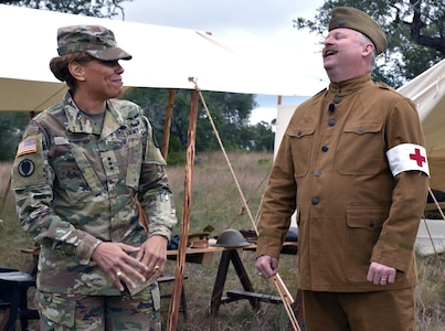 Lt Gen. Nadja Y. West, Surgeon General of the U.S. Army and commanding general, U.S. Army Medical Command, with Scott C. Woodard Historian, Office of Medical History, at the World War I medical first aid station. The theme for this year's competition was World War I with cadre members operating the lanes dressed in period uniforms.