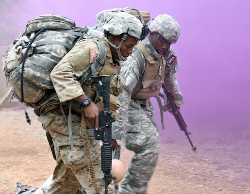 Staff Sgt. Lionel Semon and Sgt. Rolando Fender, assigned to the Airborne and Ranger Training Brigade drag an injured Soldier out of harms way during the tactical combat casualty care (TC3) lane.