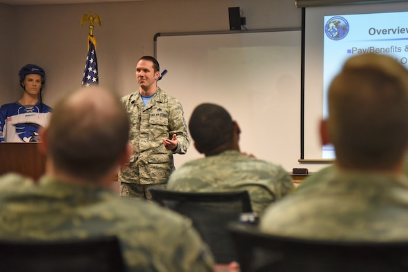 Master Sgt. Lance Hasz, 92nd Force Support Squadron Career Assistance Advisor, talks with Airmen during an Informed Decision Briefing Oct. 27, 2017, at Fairchild Air Force Base, Washington. Hasz is one of less than 100 CAAs Air Force-wide. His position focuses on three vital aspects: customer service, regulated courses such as FTAC and professional development. (U.S. Air Force photo/Senior Airman Mackenzie Richardson)
