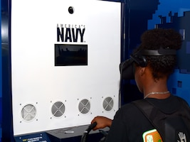 "SAN ANTONIO – (Nov. 3, 2017) A student attending Sam Houston High School was amongst 3,200 high school students from San Antonio and surrounding areas who visited the Navy's virtual reality experience, the ""Nimitz"" during the 2017 Joint Base San Antonio Air Show and Open House aboard JBSA-Lackland Kelly Field Annex.  The experience began with a video briefing on a Special Warfare Combatant-Craft Crewmen mission to extract Navy SEALs, the virtual reality mission, and a debriefing on participants' performance during the mission."