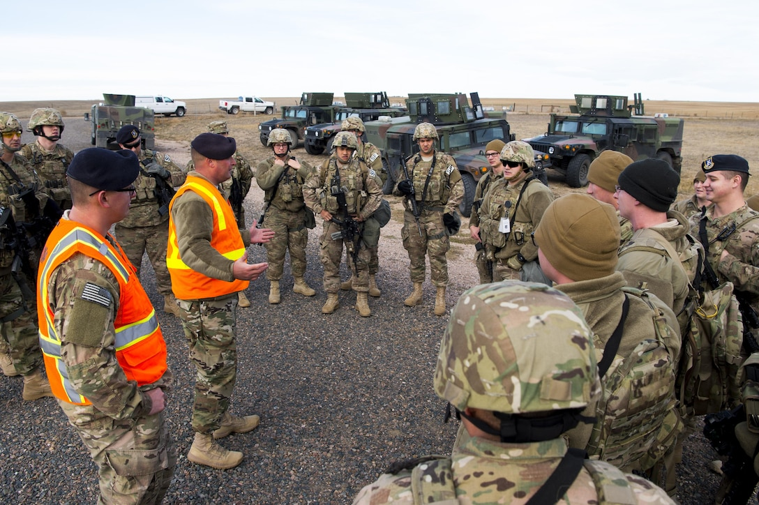 Airmen in a circle getting talked to