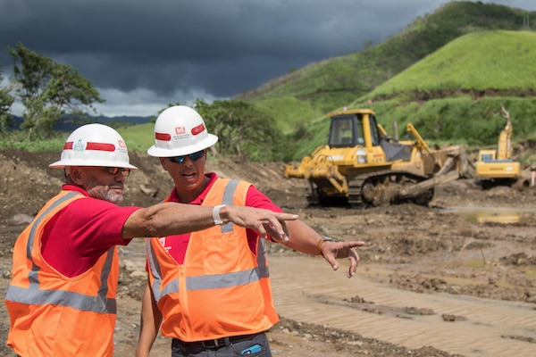YAUCO, Puerto Rico -- Wilmel Varela, right, the Resident Engineer for the Army Corps of Engineers construction and military projects in Puerto Rico, surveys the levee construction underway in Yauco, Puerto Rico, Nov. 6, 2017. Varela, along with a team of engineers and support staff, worked long hours in order to expedite the levee project after the Yauco river burst over its banks into the Lucchetti community, destroying homes and forcing the evacuation of residents. After an in-depth review of bidding documents, the Corps released the project for quote, received bids, reviewed and awarded the contract, and had construction crews in place within four days. (U.S. Army photo by Staff Sgt. Evan Lane, 65th Press Camp Headquarters)