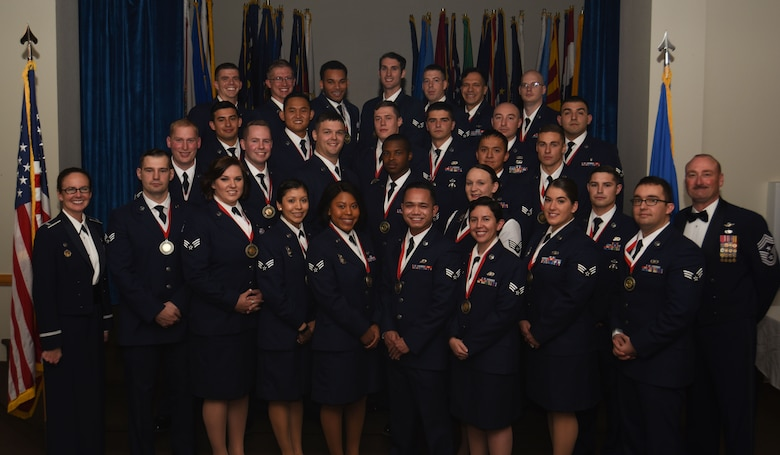 Col. Stacy Huser, 90th Missile Wing commander and Chief Master Sgt. Kristian Farve, 90th Missile Wing command chief, pose with the graduating Airman Leadership School Class 18-A students at F.E. Warren Air Force Base, Wyo., Nov. 8, 2017. Enlisted Airmen must complete this professional military education course to become supervisors of other Airmen. (U.S. Air Force photo by Airman 1st Class Abbigayle Wagner)
