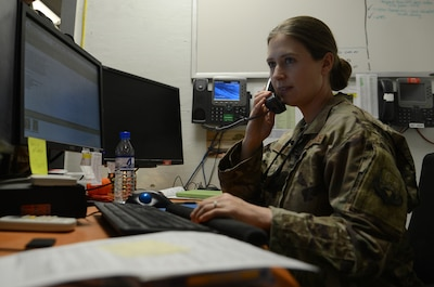 Staff Sgt. Beverly Murtiff, 455th Expeditionary Civil Engineer Squadron customer service lead, takes in a work order via phone call Nov. 6, 2017 at Bagram Airfield, Afghanistan.