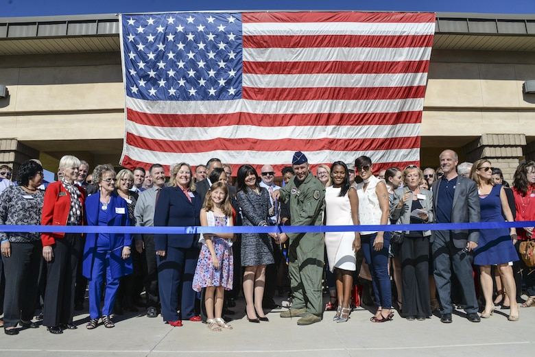 Brig. Gen. Brook Leonard, 56th Fighter Wing commander, and west valley community members cut the ribbon signifying the grand opening of the Military and Veteran Success Center at Luke Air Force Base, Ariz., Nov. 9, 2017. The MVSC is a community supported, case-managed, holistic support center for transitioning service members, veterans, and their dependents. (U.S. Air Force photo/Airman 1st Class Caleb Worpel)