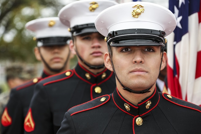 Marines look straight ahead during a ceremony.