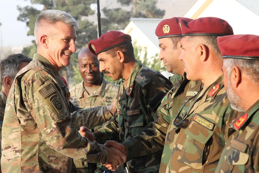 U.S. Army general shakes hands with Afghan Army officers