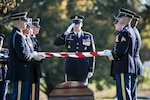Soldiers fold the flag at a funeral