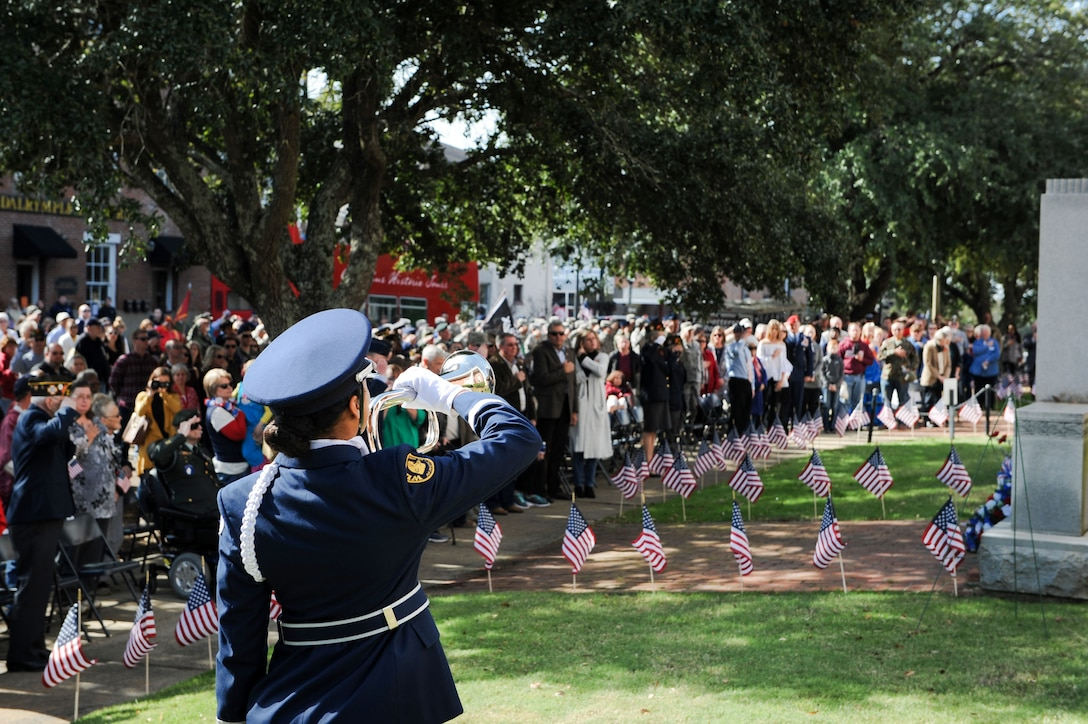 Cadet Mya Pigott, member of West Lowndes High School Air Force Junior ROTC Honor Guard, plays taps during a Veterans Day ceremony at the Lowndes County Courthouse Nov. 11, 2017, in Columbus, Mississippi. Members of the WLHS Air Force Junior ROTC also presented the colors during the ceremony. (U.S. Air Force photo by Staff Sgt. Christopher Gross)
