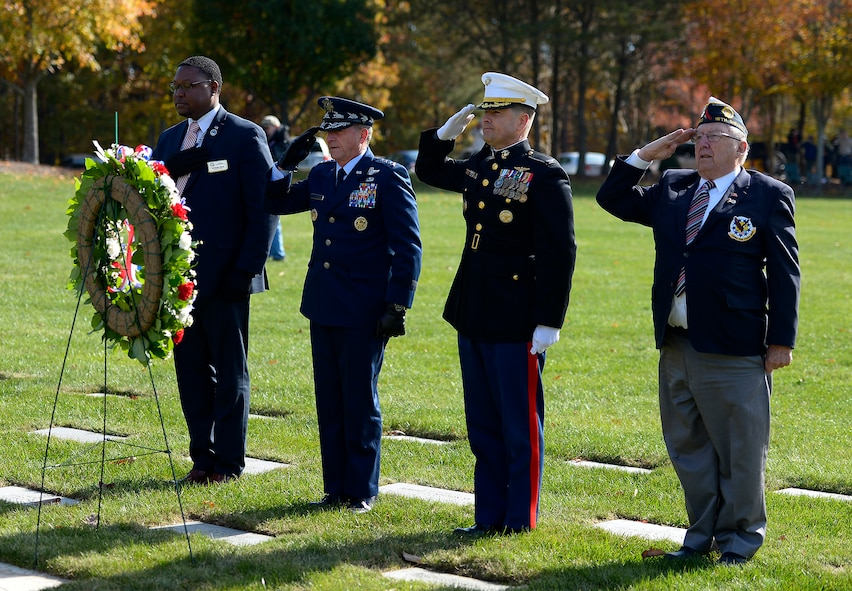 Air Force Chief of Staff Gen. David L. Goldfein salutes after placing a wreath during a Veterans Day ceremony at Quantico National Cemetery in Quantico, Va., Nov. 11, 2017. The Veterans Day ceremony is an annual event hosted by the Potomac Region Veterans Council. The event featured a performance by the Quantico Marine Corps Band. (U.S. Air Force photo by Tech. Sgt. Dan DeCook)
