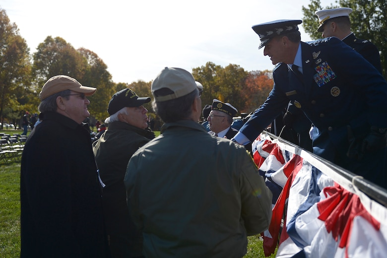 Air Force Chief of Staff Gen. David L. Goldfein shakes hands with veterans who attended this year's Veterans Day ceremony at Quantico National Cemetery in Quantico, Va., Nov. 11, 2017. The Veterans Day ceremony is an annual event hosted by the Potomac Region Veterans Council. The event featured a performance by the Quantico Marine Corps Band. (U.S. Air Force photo by Tech. Sgt. Dan DeCook)