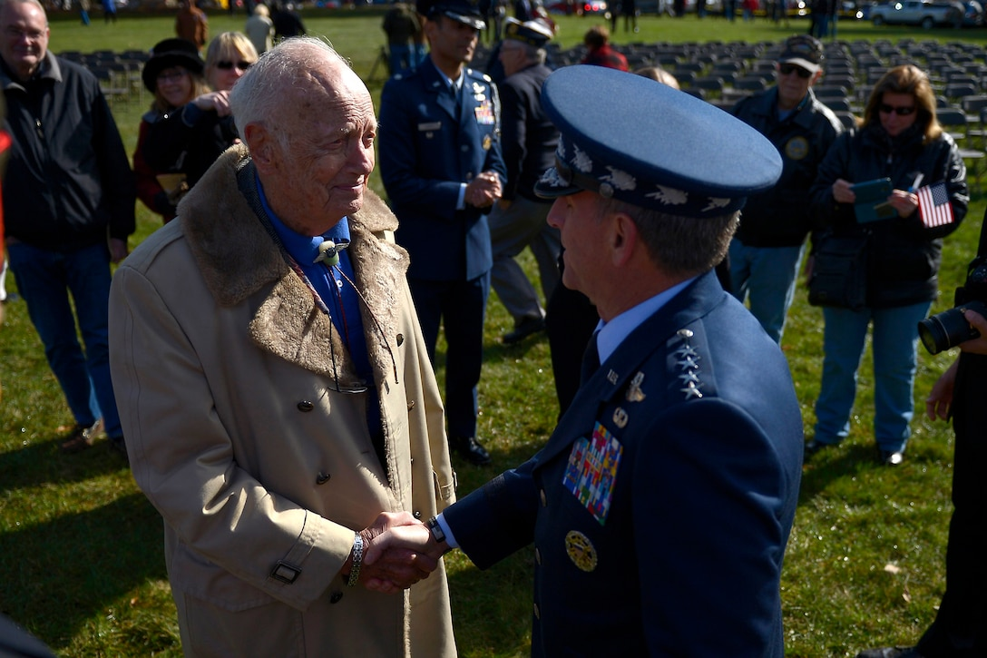 Air Force Chief of Staff Gen. David L. Goldfein shakes hands with (Ret) Col. Eugene Deatrick after a Veterans Day ceremony at Quantico National Cemetery in Quantico, Va., Nov. 11, 2017. The Veterans Day ceremony is an annual event hosted by the Potomac Region Veterans Council. The event featured a performance by the Quantico Marine Corps Band. (U.S. Air Force photo by Tech. Sgt. Dan DeCook)