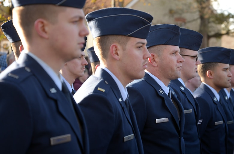 U.S. Airmen from the 100th Air Refueling Wing stand in formation during a Remembrance Day ceremony in Mildenhall, England, Nov. 12, 2017. Airmen, civic leaders, military cadets and others gathered to honor members of the armed services who have died in the line of duty. (U.S. Air Force photo by Airman 1st Class Benjamin Cooper)
