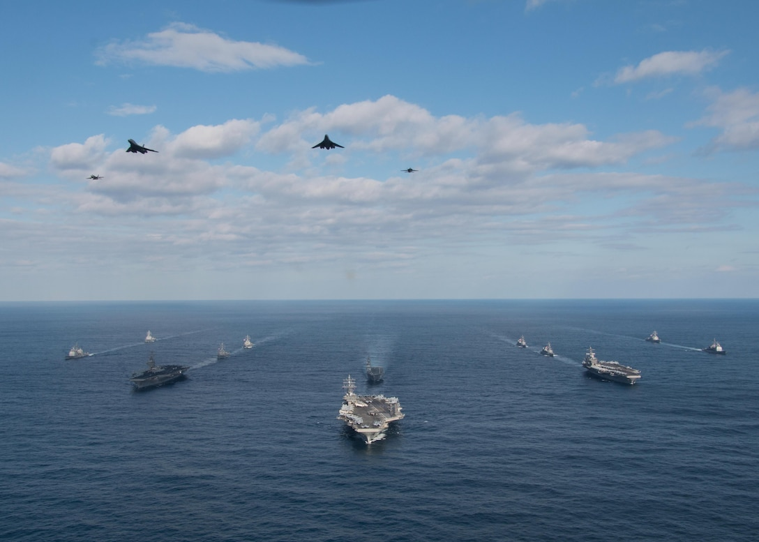 Two U.S. Air Force B-l B Lancers assigned to the 37th Expeditionary Bomb Squadron, deployed from Ellsworth Air Force Base, South Dakota, along with U.S. Navy F/A-18 Hornet fighter jets, perform a flyover of the USS Ronald Reagan (CVN 76), USS Nimitz (CVN 68), and USS Theodore Roosevelt (CVN 71) Carrier Strike Groups in the Western Pacific, Nov. 11, 2017.