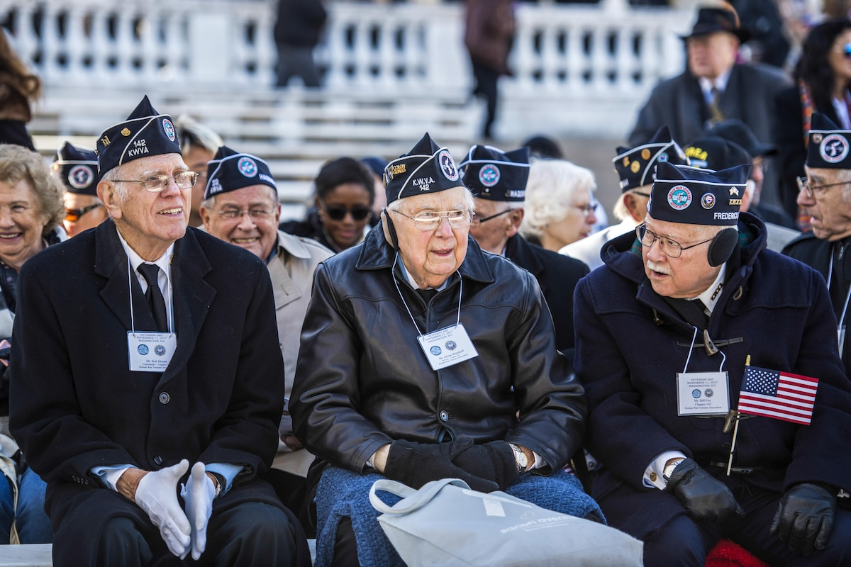 Veterans sit at the Memorial Amphitheater.