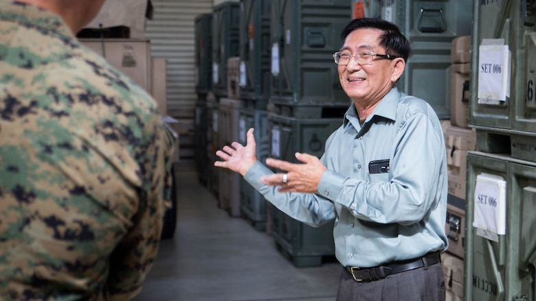 Sonny Wong, a Vietnam veteran, shares stories about the unit during his tour of 12th Marine Regiments facilities Nov. 7, 2017, at 12th Marine Regiment's company office on Camp Hansen, Okinawa, Japan.