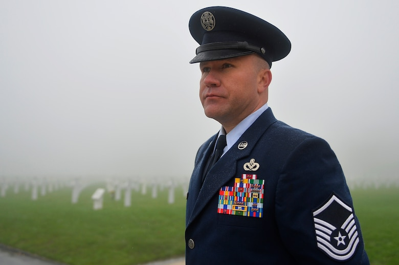 U.S. Air Force Master Sgt. Michael Murieen, 786th Civil Engineer Squadron water and fuel systems maintenance section chief, visits Henri-Chapelle American Cemetery and Memorial, Belgium, Nov. 11, 2017. Veterans Day in the U.S. originated from Armistice Day, which commemorates the end of World War I. (U.S. Air Force photo by Airman 1st Class Joshua Magbanua)