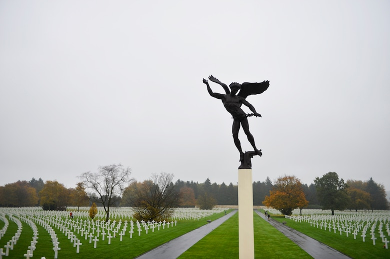 A statue towers above Henri-Chapelle American Cemetery and Memorial, Belgium, Nov. 11, 2017. The cemetery serves as the resting place for 7,992 Americans who fought in World War II. (U.S. Air Force photo by Airman 1st Class Joshua Magbanua)