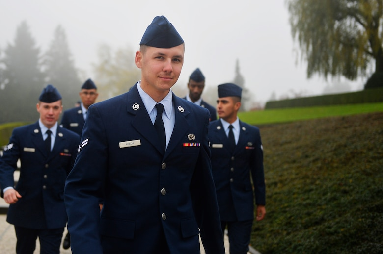 U.S. Air Force Airmen assigned to the 86th Civil Engineer Group walk towards the location of their Veterans Day Ceremony at Henri-Chapelle American Cemetery and Memorial, Belgium, Nov. 11, 2017. Dozens of 86th CEG Airmen traveled approximately three hours from Ramstein Air Base, Germany, to conduct the ceremony. (U.S. Air Force photo by Airman 1st Class Joshua Magbanua)