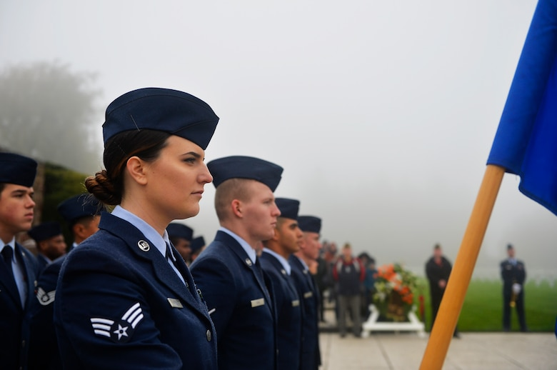 U.S. Air Force Airmen assigned to the 86th Civil Engineer Group stand in formation during a Veterans Day Ceremony at Henri-Chapelle American Cemetery and Memorial, Belgium, Nov. 11, 2017. The ceremony included speeches, a wreath-laying presentation, a hereditary nine gun salute, and a playing of the Belgian and American national anthems. (U.S. Air Force photo by Airman 1st Class Joshua Magbanua)