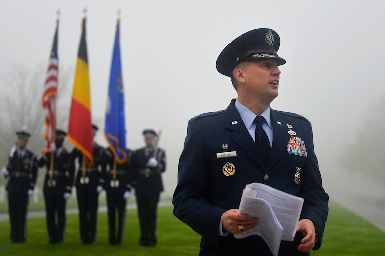 U.S. Air Force Col. Brian Hartless, 86th Civil Engineer Group commander, gives a speech during a Veterans Day Ceremony at Henri-Chapelle American Cemetery and Memorial, Belgium, Nov. 11, 2017. During his speech, Hartless highlighted the significance of Veterans Day, adding that it illustrates the commitment of U.S. service members to serve their country and build partnerships with their allies. (U.S. Air Force photo by Airman 1st Class Joshua Magbanua)