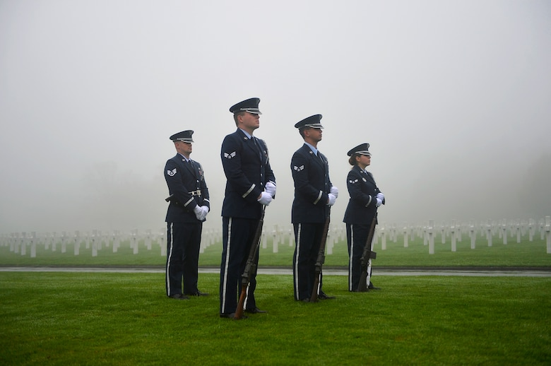 Members of an Air Force honor guard team stand in formation during a Veterans Day ceremony at Henri-Chapelle American Cemetery and Memorial, Belgium, Nov. 11, 2017. The team conducted a hereditary nine gun salute which historically signifies an end to hostilities for a period of time. (U.S. Air Force photo by Airman 1st Class Joshua Magbanua)
