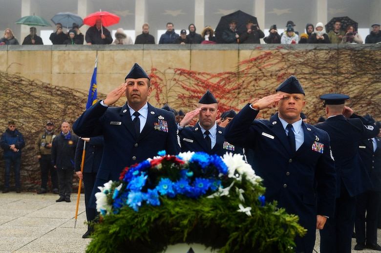 U.S. Air Force Airmen assigned to the 86th Civil Engineer Squadron salute after laying a wreath during a Veterans Day ceremony at Henri-Chapelle American Cemetery and Memorial, Belgium, Nov. 11, 2017. Besides wreath-layings, the ceremony included speeches from distinguished visitors and a hereditary nine gun salute. (U.S. Air Force photo by Airman 1st Class Joshua Magbanua)