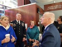 Colonel Thomas Asbery (middle) Commander, New York District, and esteemed guests speak with Major General Garrett Harencak, Commander, Air Force Recruiting Service, at the Times Square Recruiting Center in New York City.