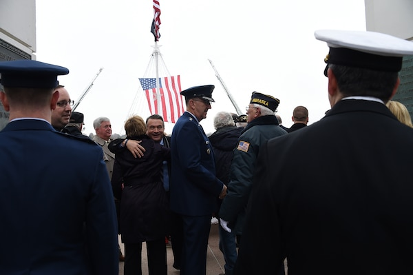 U.S. Air Force Gen. John Hyten (center), commander of U.S. Strategic Command, speaks with a member of the rifle team before a Veterans Day ceremony at Memorial Park in Omaha, Neb., Nov. 11, 2017. More than 200 people attended the ceremony to honor the service and sacrifice of American veterans and their families.