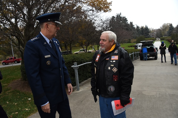 U.S. Air Force Gen. John Hyten, commander of U.S. Strategic Command, speaks with Lonnie Ford, a Gold Star father, before a Veterans Day ceremony at Memorial Park in Omaha, Neb., Nov. 11, 2017. Ford's son, U.S. Army Sgt. Joshua Ford, was killed July 31, 2000, during combat operations in Al Numaniyah, Iraq. More than 200 people attended the ceremony to honor the service and sacrifice of American veterans and their families.