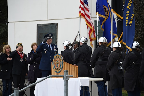 U.S. Air Force Gen. John Hyten, commander of U.S. Strategic Command, and other distinguished guests pay respects to the United States flag during a Veterans Day ceremony at Memorial Park in Omaha, Neb., Nov. 11, 2017. More than 200 people attended the ceremony to honor the service and sacrifice of American veterans and their families.